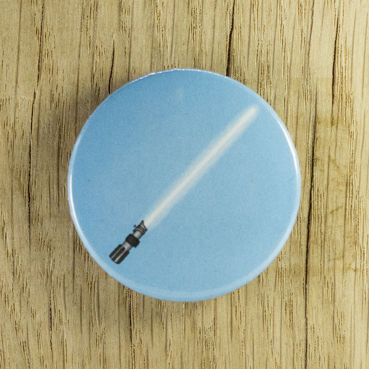 Badge sabre bleu – Star Wars